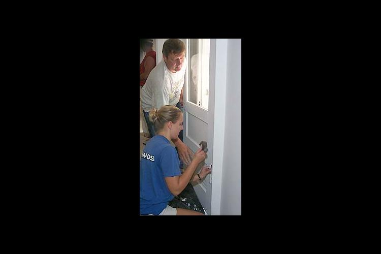 Habitat For Humanity Volunteers work on a house renovation in Lee County. All Habitat eligible families must be enrolled in UK's Expanded Food and Nutrition Education Program.