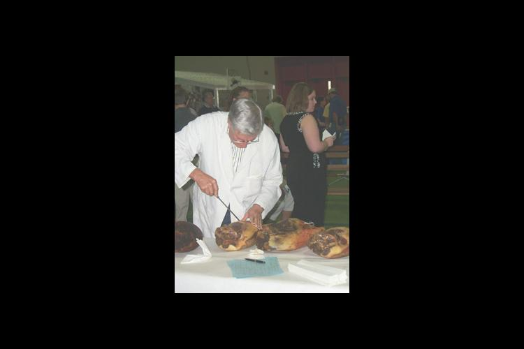 A judge examines hams during the second 4-H ham contest that was held in Cloverville, located in the West Wing of the Kentucky State Fair and Exposition Center