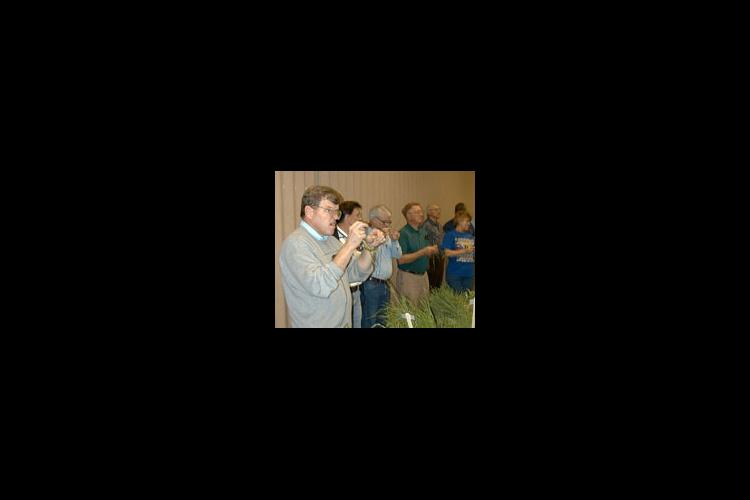 UK Extension Weed Scientist James Martin and participants of the 2000 IPM school identify pests during part of the training session.