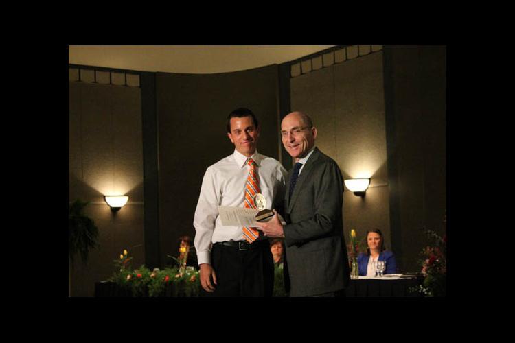 UK President Eli Capilouto presents Patrick B. Johnson with the Algernon Sydney Sullivan Award.