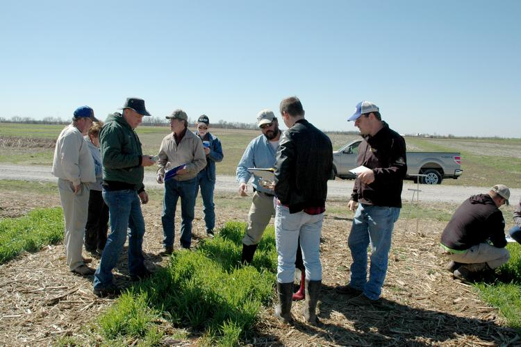 UK soil scientist Edwin Ritchey, center, talks to participants during a previous school.