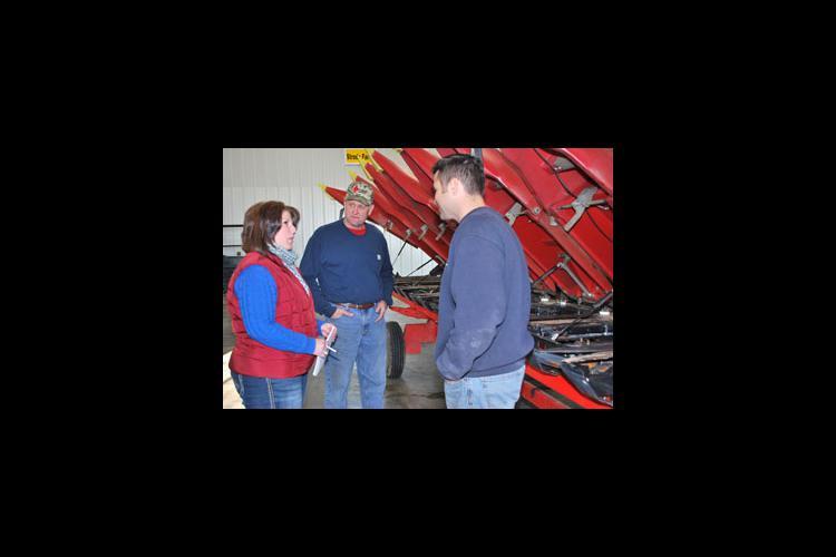 Suzy Martin talks with her Kentucky Farm Business Management clients Richard Strode, center, and Jason Strode.