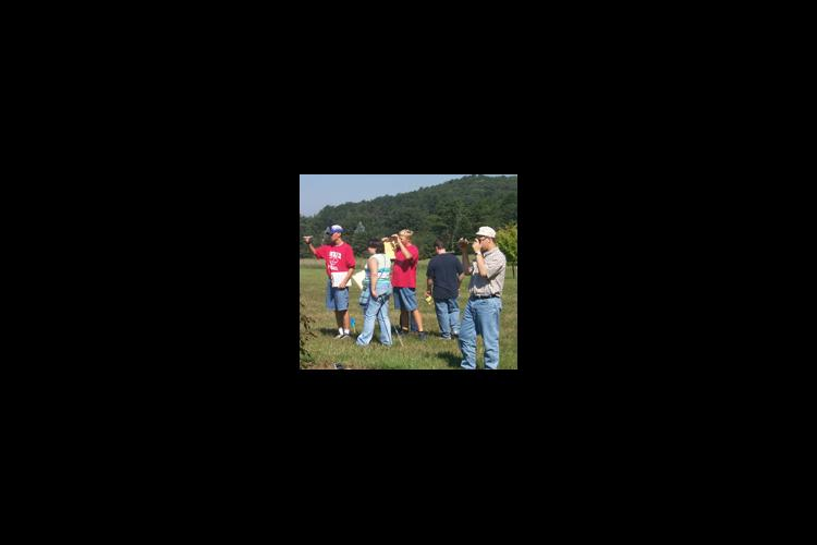 4-H members attempt to determine the slope of a site as part of the state 4-H land judging contest.