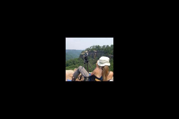 Tina LeDeur records falcon behavior in the Red River Gorge.