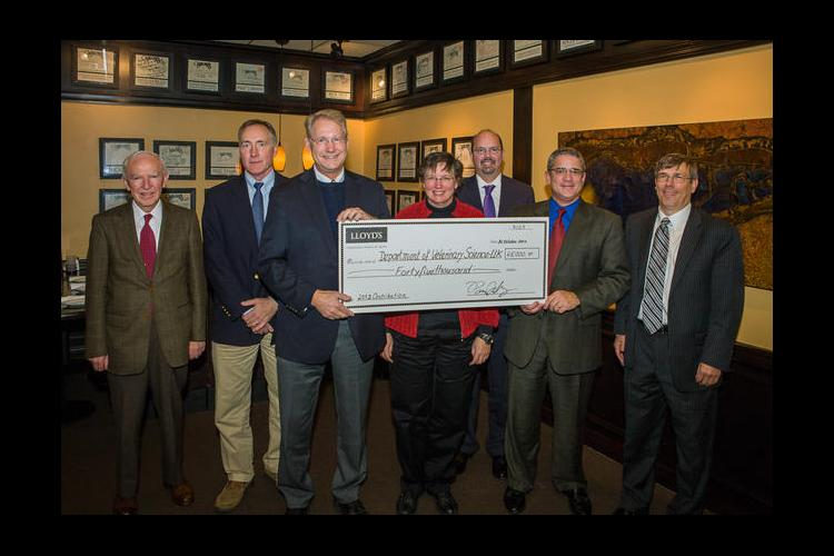 UK representatives receive a check from Bill Wallace, Pat Talley and Ken Maier of Lloyd's of London.