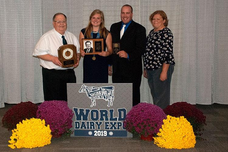 From left: Dr. Dave Selner, executive director of the National Dairy Shrine, UK student Madison Dyment,  Derek Nolan, UK graduate student and team coach, and  Larissa Tucker, UK senior extension associate for Dairy Youth Programs. Photo submitted.