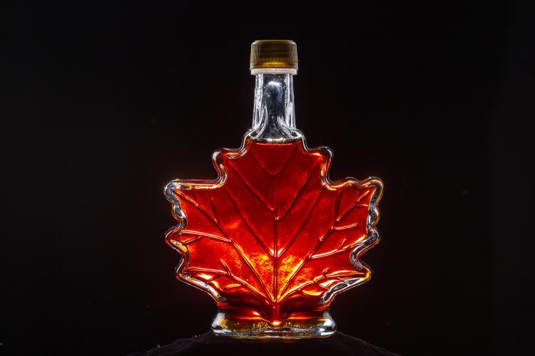 Maple syrup bottle shaped like a maple leaf