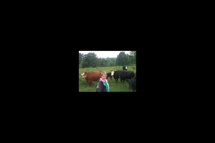 Sara Jane Rankin, a retired middle school teacher, stands in a pasture on her Shelby County farm.
