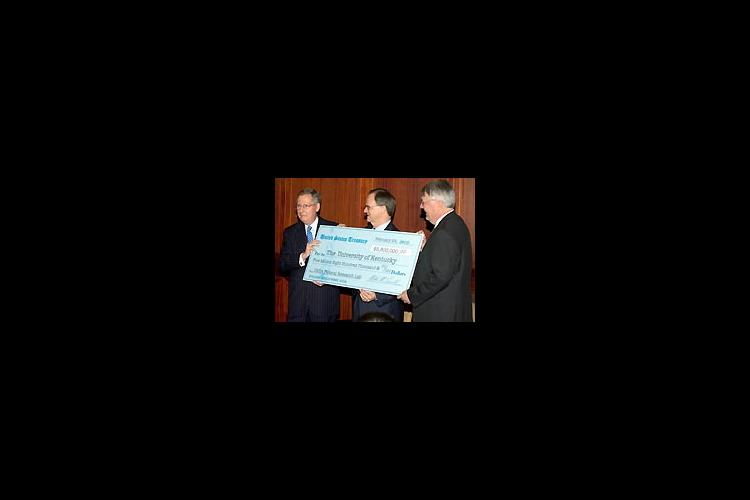 Senator McConnell presents a check to UK President Lee T. Todd, Jr. and UK College of Agriculture Dean Scott Smith.