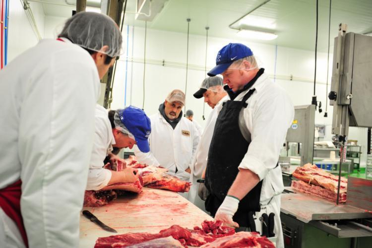 Gregg Rentfrow teaches meat cutting class.