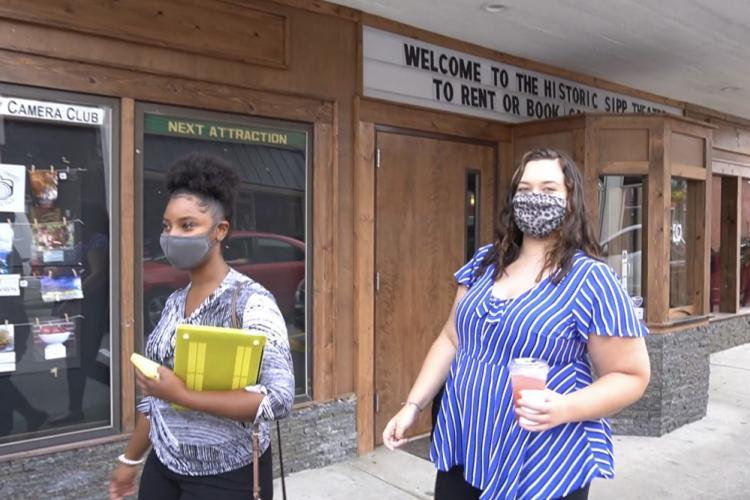 Mia Thompson and Lexi Stewart walk down a street in Paintsville, Kentucky