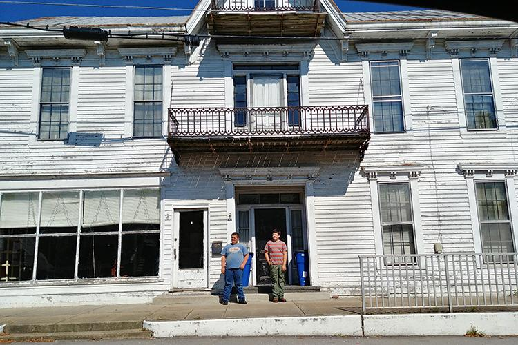 Andrew and Nate Gray stand in front of the historic Louisiana Hotel in Robertson County. Photo provided.