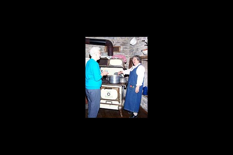 Norma Jean serves up soup beans and cornbread from her 1790's kitchen in Washington County.