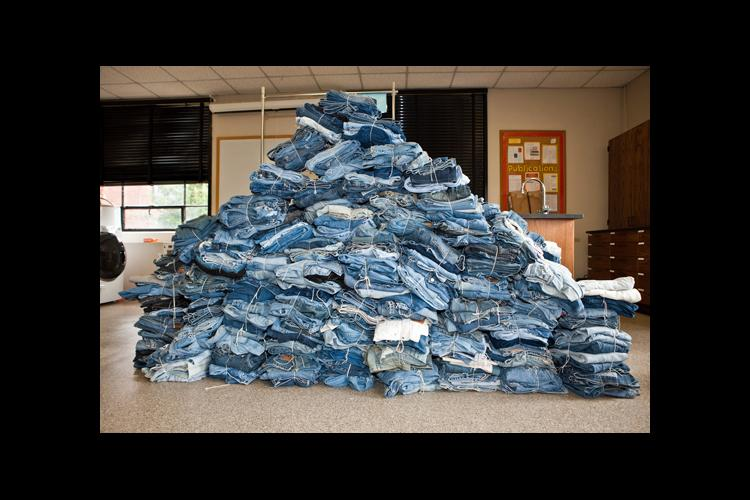A pile of jeans collected during a previous year's denim drive.