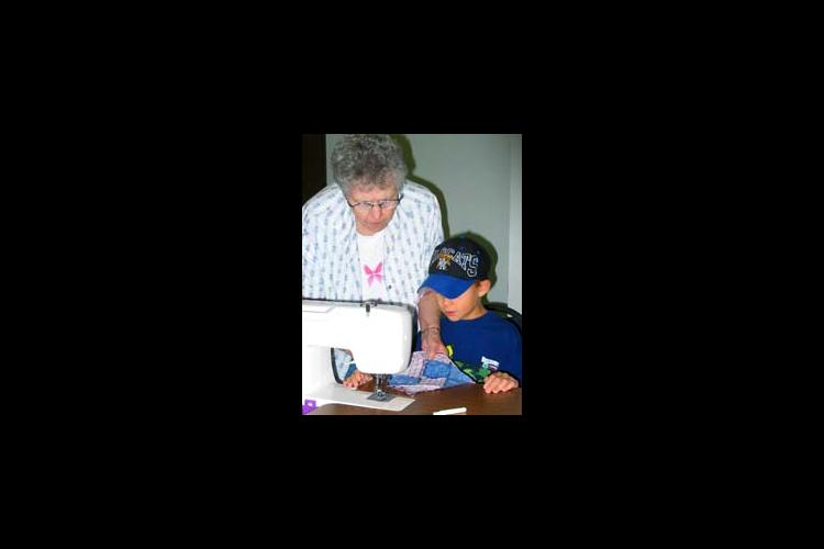 Sue Hutchison lends a helping hand to Austin Page.