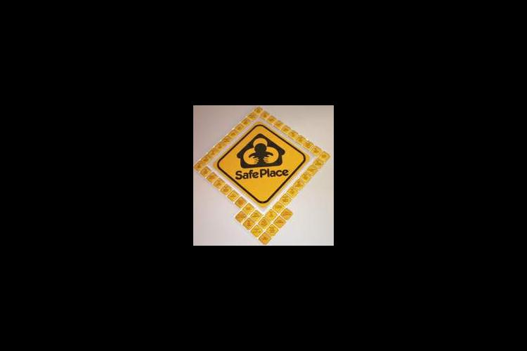 This symbol is displaced outside businesses throughout the Louisville area identifying them as a place where teens can go to find a Safe Place.