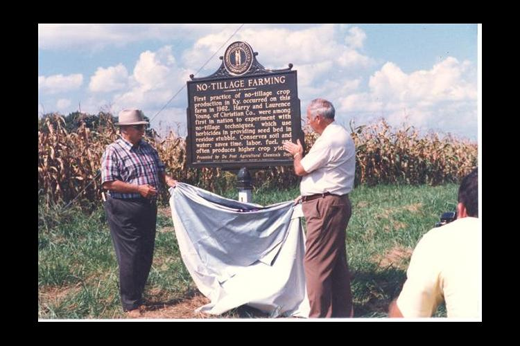 Harry Young Jr, left, and Shirley Phillips unveil the No-Tillage Farming historical marker on Young's farm in 1985.
