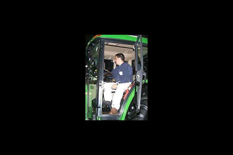 UK Ag Engineer, Scott Shearer, checks a computer in a tractor at the farm machinery show.
