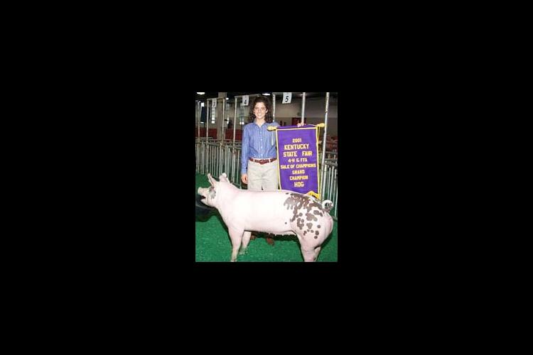 Susan Lee of Clark Co. with her 2001 Grand Champ. Hog at the Kentucky State Fair.