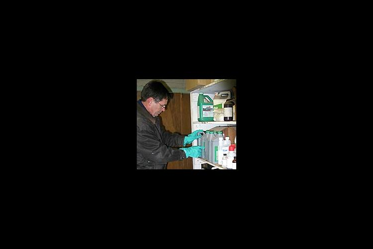 Townsend checks pesticide labels and storage conditions.