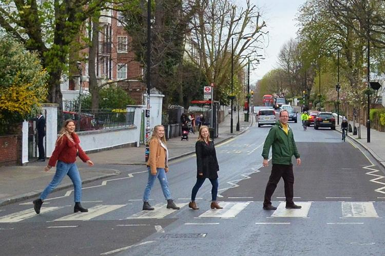UK students from left: Catie Archambeau, Arizzona Albright and Emma Rosenzweig and Jason Swanson, UK associate professor, recreate the famous Beatles album cover at the Zebra Crossing at Abbey Road Studios in London. Photo by Wilson Blakeman.