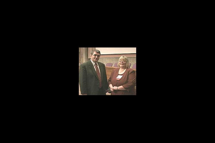 Dr. Rodney Brown, USDA deputy under secretary for research, education and economics, congratulates Vella Adkins.