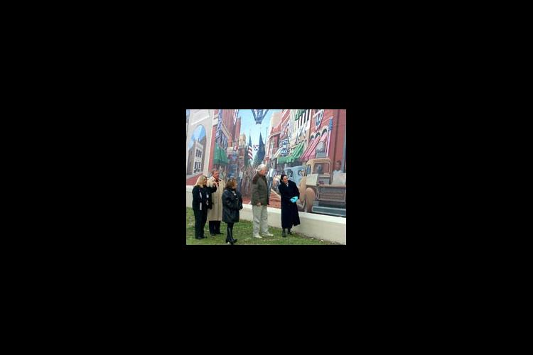 From left to right: Micah Williamson, Mayor Roger Hensley, Nikki Baker, Sid Rice, and Suellen Zornes enjoy the detail of a mural of the old Front Street in Catlettsburg