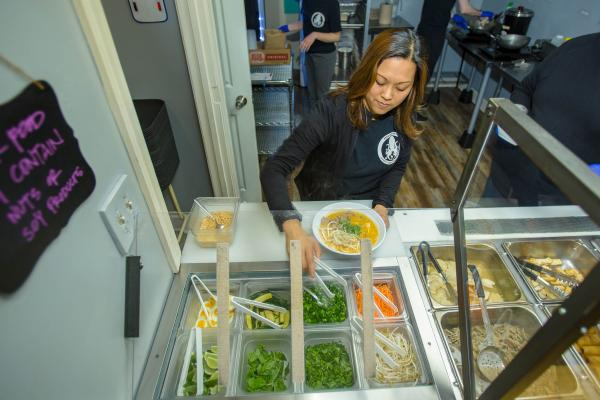 Mae Suramek dishes out noodles in her Berea restaurant, Noodle Nirvana.
