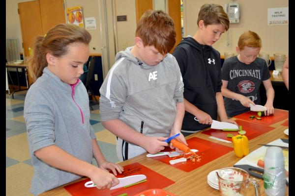 Owen County fifth-graders chop up vegetable appetizers during the Recipes for Life Program. Photo by Katie Pratt, UK agricultural communications.