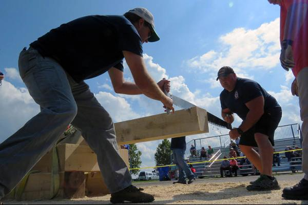 Police and fire teams compete during Lumberjack Games at the 2017 Wood Expo.