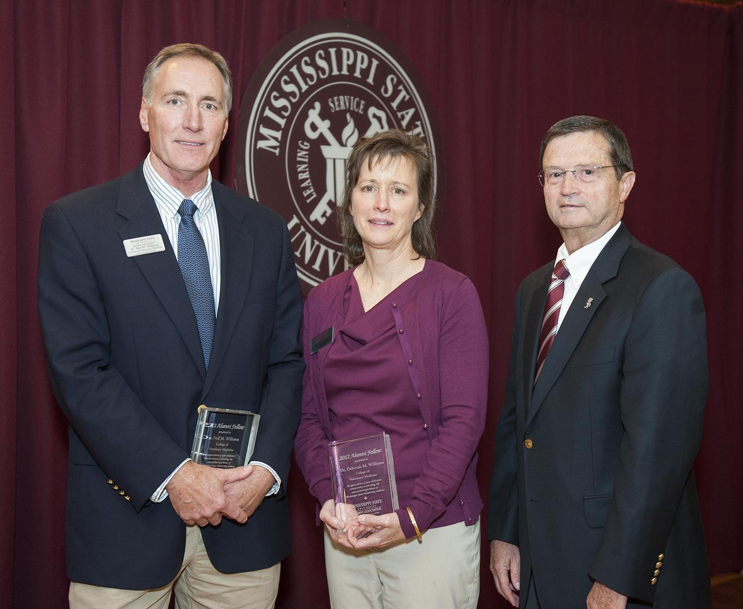 Dr. Neil M. Williams, left, and his wife Dr. Deborah Maples Williams, with Kent Hoblet, dean of the MSU College of Veterinary Me