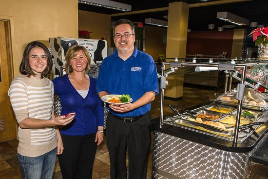 From left Mallory Foster, Kelly Webber and Ray Schmidt in one of the on-campus eateries featured on the UK Food app.