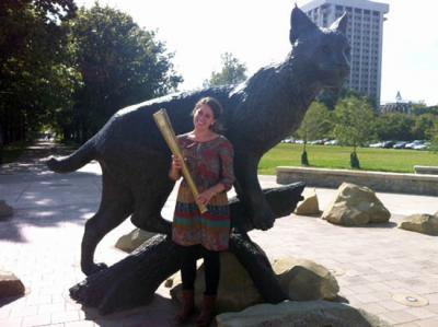 UK alumna Taylor Amerman carried the Olympic Torch in 2012.