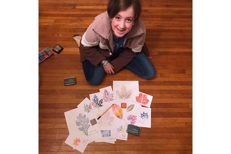 Carroll County 4-H'er Brenna Mefford shows off her leaf print collection that she made in another 4-H program. 4-H'ers who become Junior Master Naturalists will make a similar collection. Photo provided.