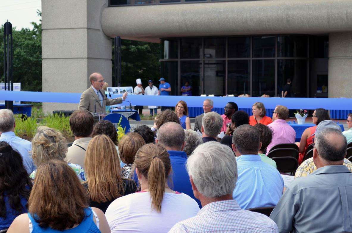 UK President Eli Capilouto addresses people gathered for dedication of CAFE Alumni Plaza.