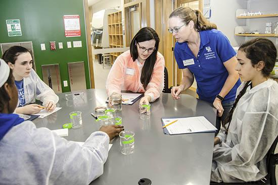 Carmen Agouridis oversees middle-school students learning about the process of water purification.