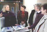 Susan Harkins explains plans of her new certified kitchen to women attending the 2003 Women in Agriculture Conference.