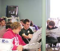 Workshop participants study maps  as part of their training. Photo by Wanda Paris