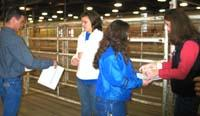 NAILE interns mark stalls for incoming beef cattle.