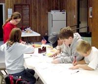 Orangeburg 4-Hers write letters to U.S. troops.