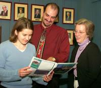 Keisa Bennett (left), discusses community development with Rodney Hitch and Martha Perkins.