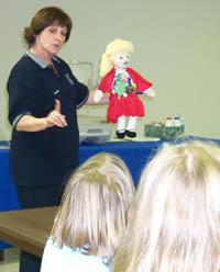 Teacher with doll