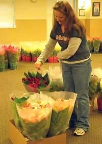 Staff assistant Sue Ellen Stull prepares an order for pick up.