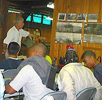 Scholars receive instruction from Carroll Fackler at Robinson Station.