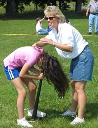 Jennifer Howard helps a student during one of the spin competitions.