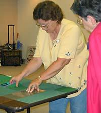 Claudine Williamson, president of Greenup County Homemakers, learns basic quilting skills.