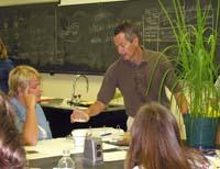 Mark Farman, UK Plant Pathologist, explains an experiment to high school teachers.