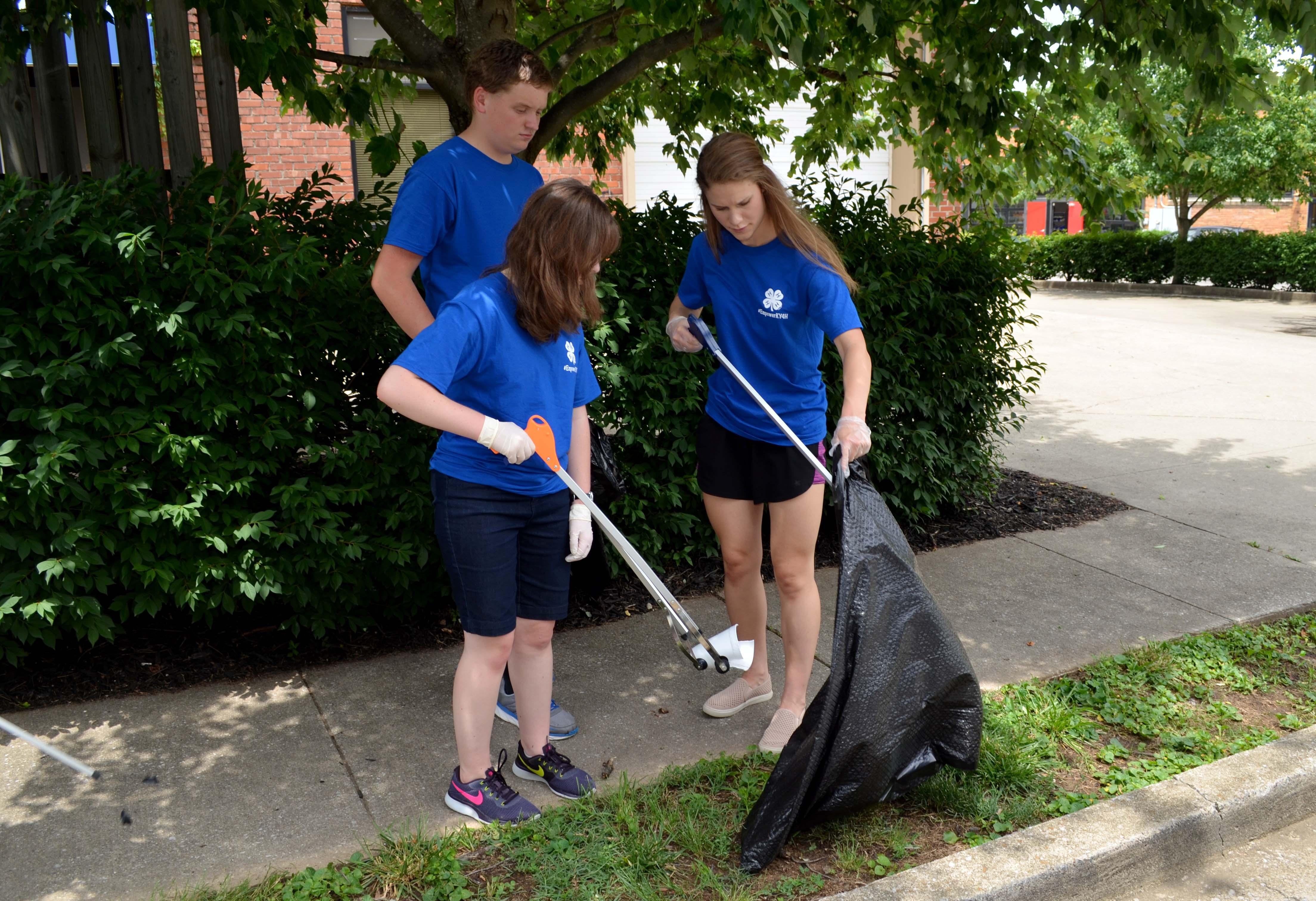 Kentucky 4-H'ers pick up litter in a Lexington community as part of their community service project at 4-H Teen Conference.