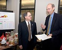 UK President Lee T. Todd Jr. talks with Associate Dean and Director of UK Cooperative Extension Larry Turner after the announcement of the Drug Endangered Children Alliance.
