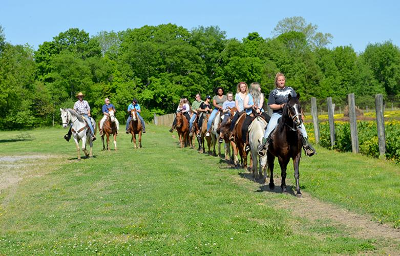 Cast and crew members of Transformative Travels ride horses at the Rocking U Riding Stables at Wrangler Campground in the Land Between the Lakes National Recreation Area. Photo by Katie Pratt, UK agricultural communications.